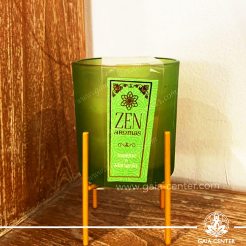 Aroma Scented Candle with Fragrance Jasmine and Marigold in a vibrant glass holder with a metal stand. At Gaia Center   Cyprus.