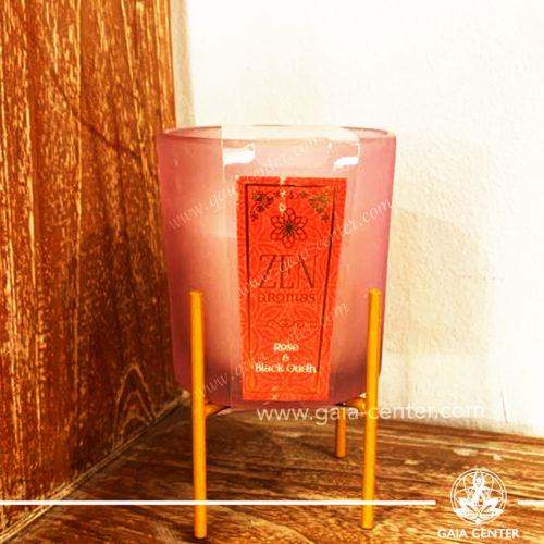 Aroma Scented Candle with Fragrance Rose and Black Oudh in a vibrant glass holder with a metal stand. At Gaia Center   Cyprus.