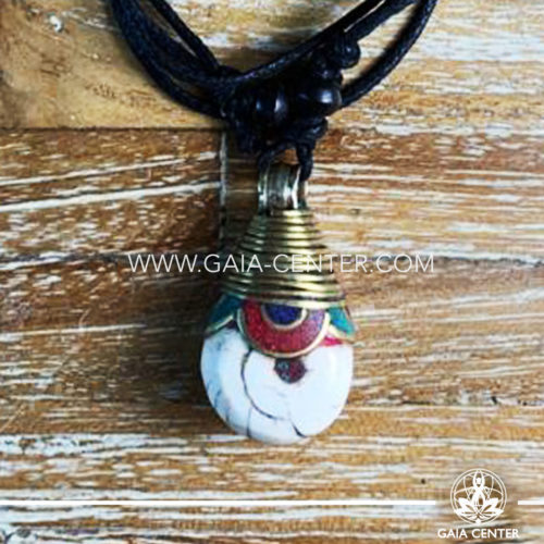 Tibetan Pendant style. Metal inlaid with semiprecious gemstones. Adjustable black string. Selection of Tibetan Jewelry made from crystals, gemstones, combination of metals at Gaia Center   Cyprus.