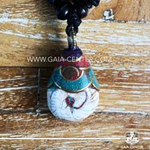 Tibetan Pendant style. Metal inlaid with semiprecious gemstones. Adjustable black string. Selection of Tibetan Jewelry made from crystals, gemstones, combination of metals at Gaia Center | Cyprus.