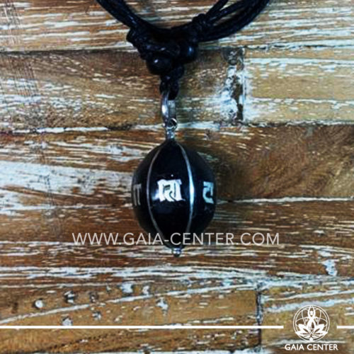 Tibetan Pendant Black Drop Style design. Made from combination of metals and semiprecious stone. Adjustable black cord or string. Selection of Tibetan jewelry at Gaia Center   Cyprus.