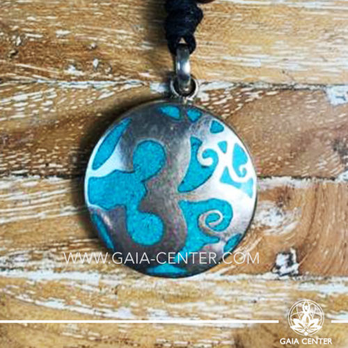 Crystal Tibetan Pendant with om symbol. Metal inlaid with semiprecious gemstones. Adjustable black string. Selection of Tibetan Jewelry made from crystals, gemstones, combination of metals at Gaia Center   Cyprus.