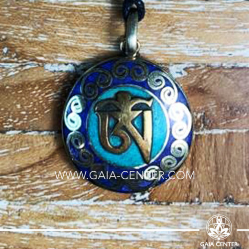 Tibetan Pendant with om symbol. Metal inlaid with semiprecious gemstones. Adjustable black string. Selection of Tibetan Jewelry made from crystals, gemstones, combination of metals at Gaia Center | Cyprus.