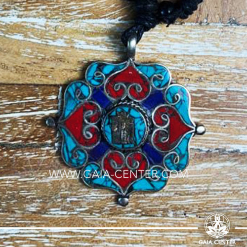 Tibetan Pendant artistic decor design. Red coral, lapis lazuli and turquoise. Adjustable black string. Selection of Tibetan Jewelry made of crystals, gemstones, combination of metals at Gaia Center   Cyprus.