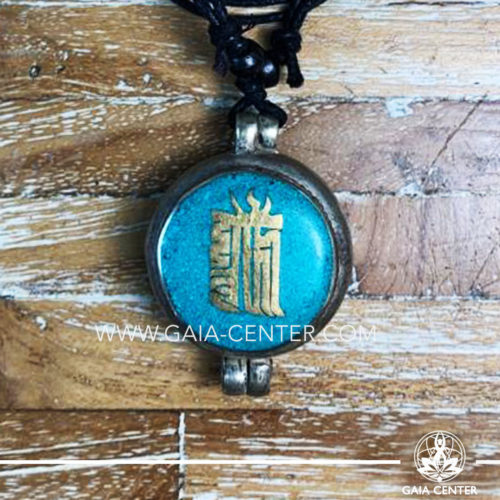 Tibetan Pendant Gau box amulet with Kalachakra symbol. Metal inlaid with semiprecious gemstones. Adjustable black string. Selection of Tibetan Jewelry made from crystals, gemstones, combination of metals at Gaia Center | Cyprus.