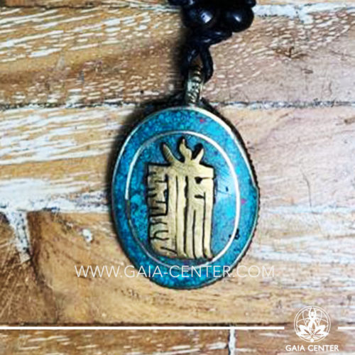 Tibetan Pendant with Kalachakra symbol. Metal inlaid with semiprecious gemstones. Adjustable black string. Selection of Tibetan Jewelry made from crystals, gemstones, combination of metals at Gaia Center   Cyprus.