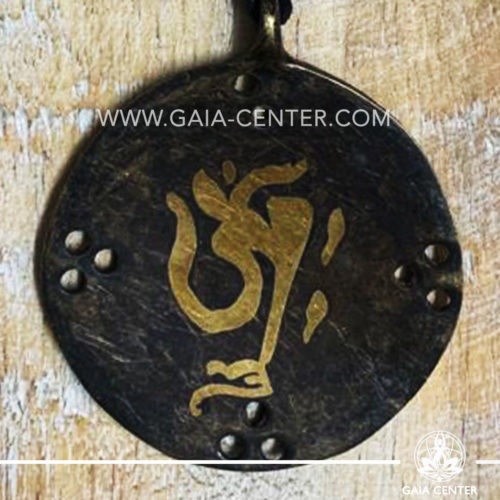 Tibetan Pendant Om symbol design. Made from combination of metals, silver color style. On an adjustable black string. Tibet Selection of Tibetan Jewelry made from crystals, gemstones, combination of metals at Gaia Center | Cyprus.
