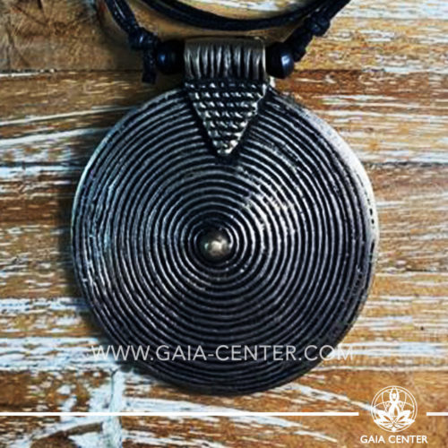 Tibetan Pendant Spiral Bronze color design. Made from combination of metals. Comes with adjustable black string. Tibet Selection of Tibetan Jewelry made from crystals, gemstones, combination of metals at Gaia Center | Cyprus.