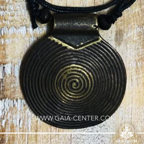 Tibetan Pendant Spiral design. Made from combination of metals, silver color style. On an adjustable black string. Tibet Selection of Tibetan Jewelry made from crystals, gemstones, combination of metals at Gaia Center | Cyprus.