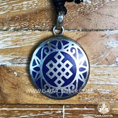Crystal Pendant and Semiprecious Gemstone. Tibetan Pendant Endless knot buddhist symbol inlaid with crystal stone -crushed lapis lazuli. Adjustable black string. Selection of Tibetan Jewelry made from crystals, gemstones, combination of metals at Gaia Center   Cyprus.