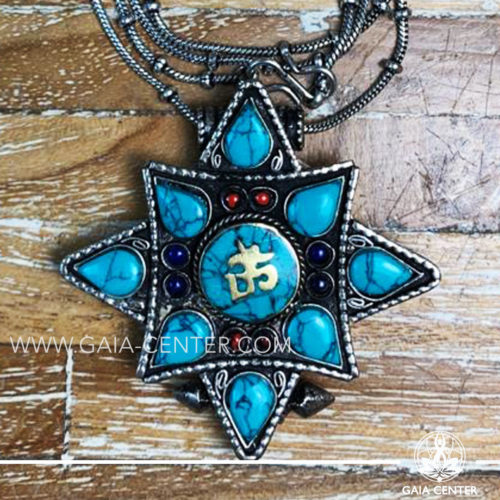Crystal and Semiprecious Gemstone Pendant. Tibetan Pendant Gau box amulet with Buddha wisdom eyes symbol. Metal inlaid with semiprecious gemstones. Adjustable black string. Selection of Tibetan Jewelry made from crystals, gemstones, combination of metals at Gaia Center | Cyprus.