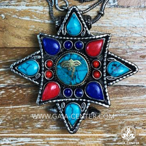 Crystal and Semiprecious Gemstone Pendant. Tibetan Pendant Gau box amulet with Buddha wisdom eyes symbol. Metal inlaid with semiprecious gemstones. Adjustable black string. Selection of Tibetan Jewelry made from crystals, gemstones, combination of metals at Gaia Center   Cyprus.
