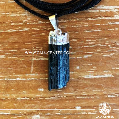 Crystal Pendant - Black Tourmaline rough pendant, silver plated on a string. Crystal Jewellery collection: semiprecious gemstone and crystal pendants selection at Gaia Center | Cyprus.