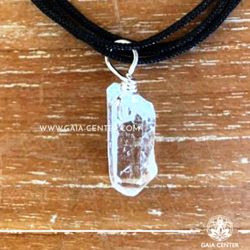 Crystal Pendant - Clear Crystal Quartz rough pendant, silver plated on a string. Crystal Jewellery collection: semiprecious gemstone and crystal pendants selection at Gaia Center | Cyprus.