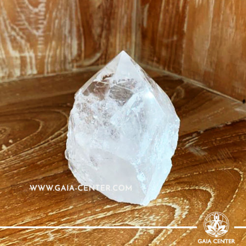 Crystal Clear Raw Quartz Rough Cut Base Polished Point from Brazil. Crystal size: H:85mm L:65mm W:70mm. Crystal and Gemstone selection at Gaia Center | Cyprus.