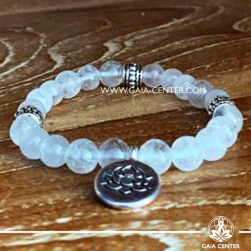 Crystal Mala Bracelet - 21 rock clear quartz crystal beads with lotus symbol metal charm. Elastic string. Crystal and Gemstone Jewellery Selection at Gaia Center in Cyprus.