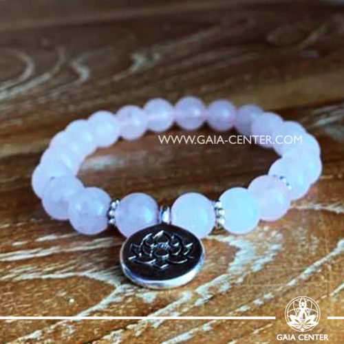 Crystal Mala Bracelet - 21 Rose quartz crystal beads with lotus symbol metal charm. Elastic string. Crystal and Gemstone Jewellery Selection at Gaia Center in Cyprus.
