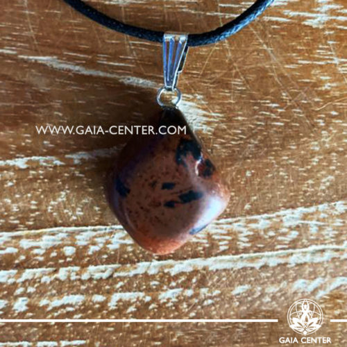 Gemstone pendant - Mahogany obsidian with metal simple zen design and adjustable cord. Crystal and Gemstone Jewellery selection at GAIA CENTER in Cyprus.