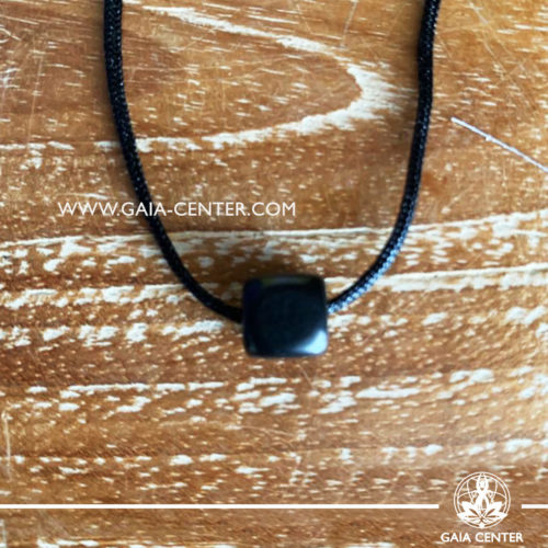 Crystal pendant Shungite Cube design with adjustable black string. Crystal and Semiprecious Gemstones Jewellery selection at GAIA CENTER in Cyprus.