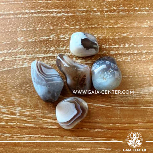 Grey Agate Eye AA quality 20-30mm Tumbled stones from Botswana. Crystals and Gemstone selection at GAIA CENTER | Cyprus.