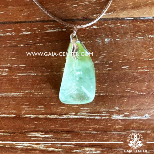 Crystal pendant - Green Calcite gemstone pendant pin drilled with metal flower and adjustable cord. Crystal and Gemstone Jewellery selection at GAIA CENTER in Cyprus.